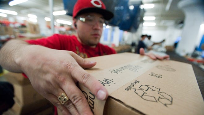 Many Americans are taking side jobs, especially in the busy holiday season.