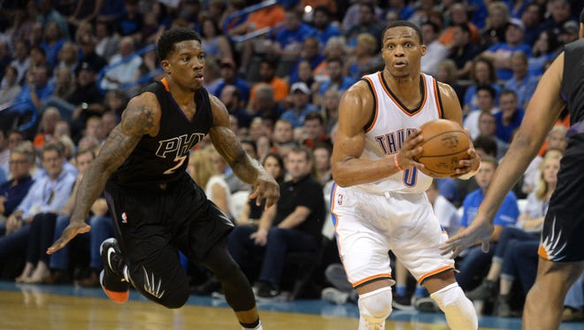 Oct 28, 2016: Oklahoma City Thunder guard Russell Westbrook (0) drives to the basket in front of Phoenix Suns guard Eric Bledsoe (2) during the second quarter at Chesapeake Energy Arena.