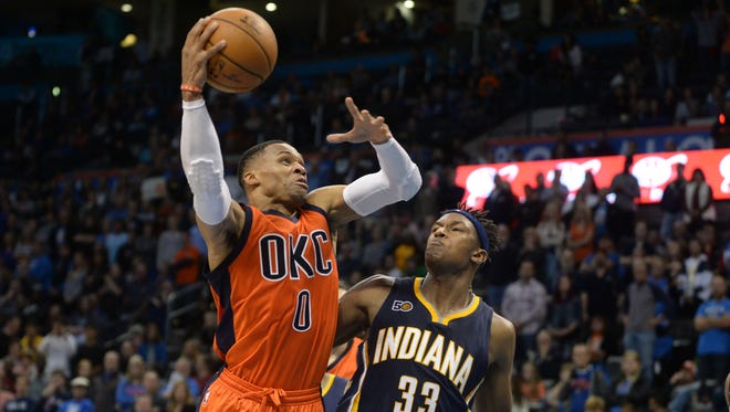 Nov 20, 2016; Oklahoma City, OK, USA; Oklahoma City Thunder guard Russell Westbrook (0) drives to the basket against Indiana Pacers center Myles Turner (33) during the fourth quarter at Chesapeake Energy Arena.