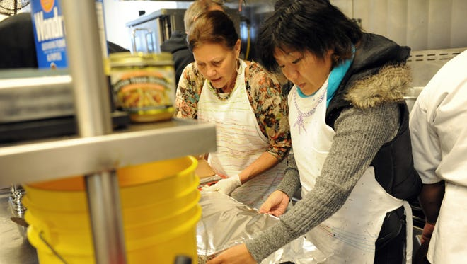 Right, reporter Amy Wu volunteers at Dorothy's Place on Thanksgiving Day