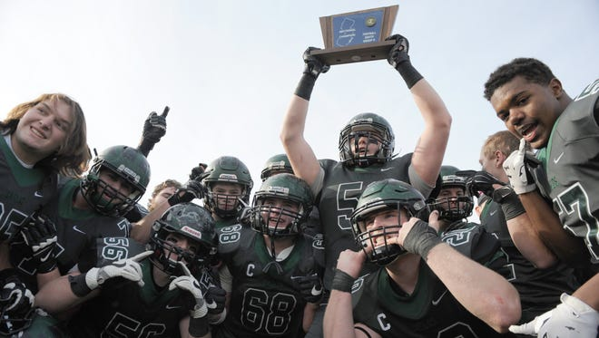 West Deptford players celebrate a 19-13 victory over  Cedar Creek in the South Jersey Group 2 championship game at Rowan University on Sunday.