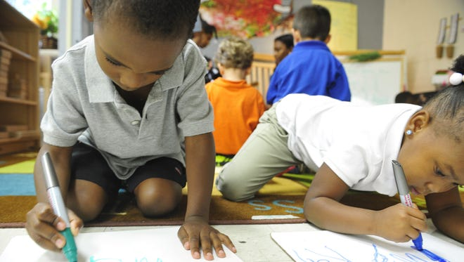in this file photo, students Maurice Chatman, left, and My'Kal Page practice writing their names in Shandereen White's pre-k class at Ross Early Learning Center in Nashville.