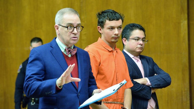 Francis Tattoli, center, appears with his attorneys Brian Neary, left, and Emil Lisboa in Judge James J. Guida's courtroom on Monday.