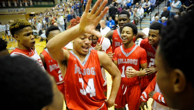 Bosse rallies before their SIAC Tournament semifinal game against Castle at North High School in Evansville, Thursday, Jan. 12, 2017.