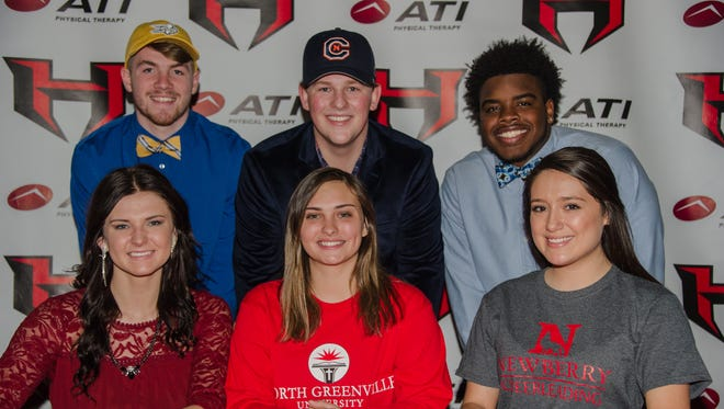 Signing Day at Hillcrest pictured left to right. Seated: Kylee Smith - Erskine, softball Maddisyn Weisman - North Greenville, lacrosse Olivia Mendoza- Newberry, cheerleading. Standing:  Alec Morton - Limestone, football Kilian Daughtry - Carson Newman, baseball Amari Houston - Lenoir Rhyne, football