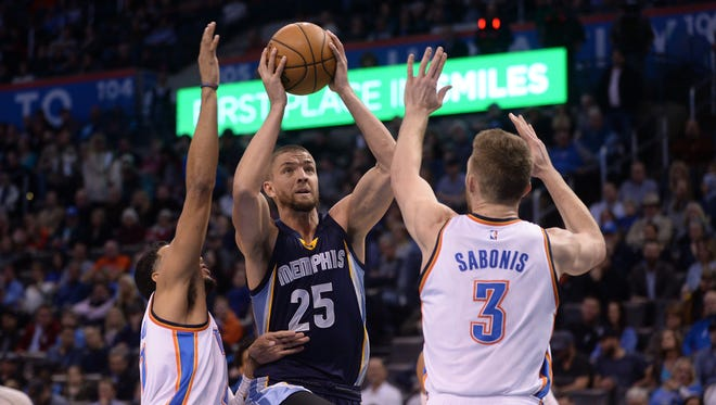 Memphis Grizzlies forward Chandler Parsons (25) prepares to shoot the ball between Oklahoma City Thunder forward Andre Roberson (21) and forward Domantas Sabonis (3) during the first quarter at Chesapeake Energy Arena on Feb. 2, 2017.