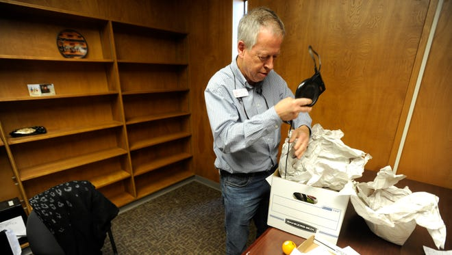 Jim Clark, director of the Christian Service Center, unpacks a box in his new office on Wednesday, March 15, 2017.