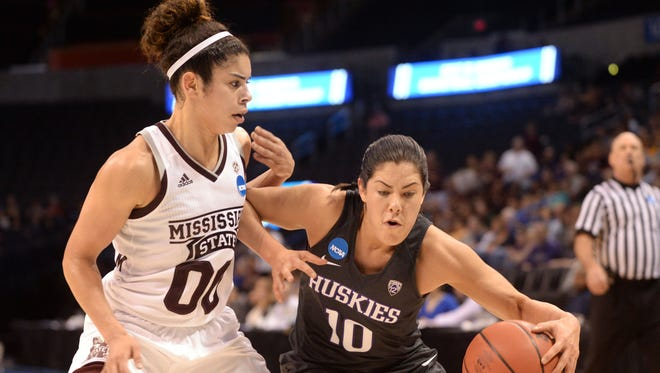 Washington guard Kelsey Plum, right, fights for position against Mississippi State guard Dominique Dillingham, left, during their regional semifinal game of the women's NCAA tournament at Chesapeake Energy Arena in Oklahoma City.