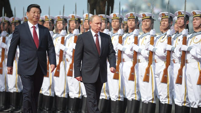 Chinese President Xi Jinping and Russian President Vladimir Putin in Shanghai on May 20, 2014.