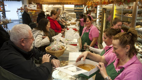 Customers line up at McMillan's in Westmont for cakes,