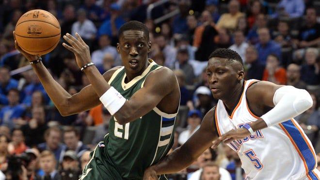 Milwaukee Bucks guard Tony Snell drives past Victor Oladipo.
