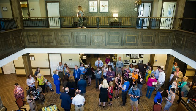 Guests mingle in the new Northshore Senior Living facility in West Knoxville after its ribbon cutting Thursday, April 13, 2017. It is the newest facility from Dover Development.