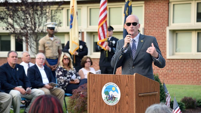 Woodland Park Mayor Keith Kazmark speaks at a June dedication of the memorial to the fallen veterans of Woodland Park at Memorial School.