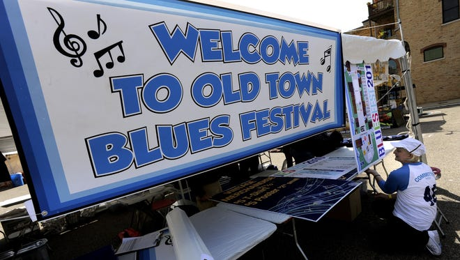 Booths and banners are set up for the 2010 Michigan BluesFest in Old Town on Sept. 17, 2010.