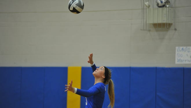 Ontario's Maddie Payne serves in the first game against Galion.