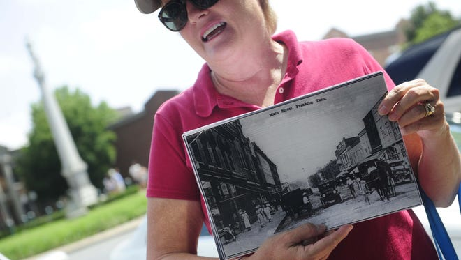 Margie Thessin talks history on the square during a new Franklin on Foot tour.