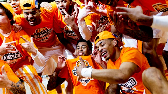 Tennessee players celebrate after winning the shared SEC Championship after defeating Georgia 66-61 at Thompson-Boling Arena in Knoxville, Tennessee on Saturday, March 3, 2018.