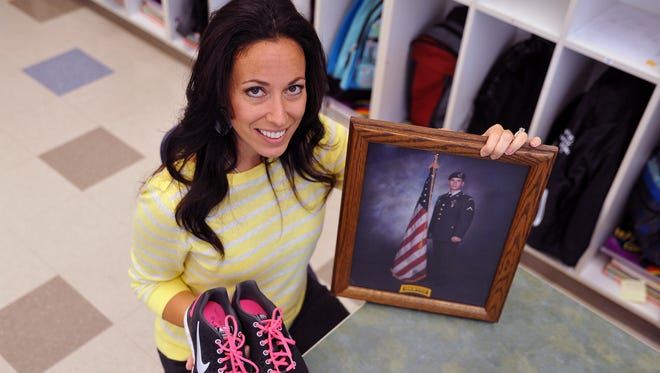 """Petway Elementary School teacher Jennifer Pilla, pictured in this October 2012 photo, ran in """"Lead the Way"""" marathon to raise money for U.S. Army Rangers. She is now asking the Vineland  school board to consider naming the Lincoln Avenue Middle School after her brother, U.S. Army Ranger Sgt. Dominick Pilla, who was killed in action while serving in Mogadishu, Somalia, featured in portrait."""