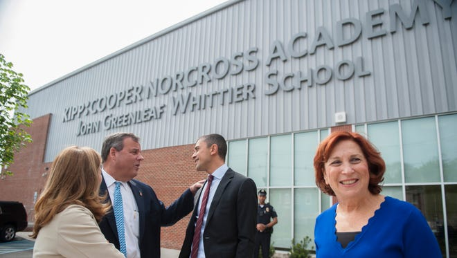 Camden schools superintendent Paymon Rouhanifard, center, speaks with former New Jersey Governor Chris Christie as they are joined by the former first lady of New Jersey, Mary Pat Christie, left, and Susan Bass Levin, President and CEO, Cooper Foundation, right, prior to a dedication ceremony of the KIPP Cooper Norcross Academy John Greenleaf Whittier Middle School in Camden on Monday, May 7, 2018.