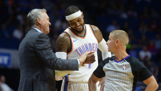 In a file photo from Oct. 3, 2017, Oklahoma City Thunder forward Carmelo Anthony (7) speaks to Houston Rockets head coach Mike D'Antoni in a break in action during the second quarter at the BOK Center.