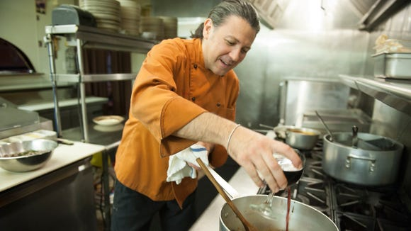 """Franco Lombardo, chef/owner of Sapori in Collingswood, cooks up some stew. He will be preparing a special """"Dinner with the Dead'' menu."""