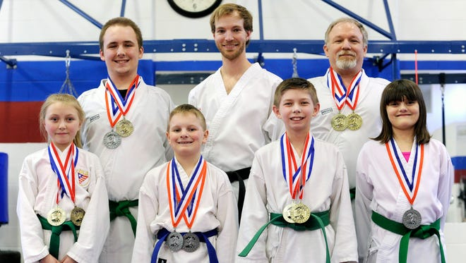 Six athletes, back row from left, Connor Ralston, instructor Barry Chenault, Jeff Ralston, bottom row from left, Nikki Brown, Charlie Lewis, Jacob Littler and Mackenzie Henry from the Team Tokey Hill Center won gold medals at 2015 Arnold Sports Festival last weekend. In addition, Jacob Littler won a scholarship and had the opportunity to have dinner with Arnold Schwarzenegger.