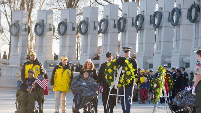 U.S. Army veterans and Pearl Harbor survivors lay a wreath on the National World War II Memorial in Washington, D.C. on Sunday, Dec. 7, 2014 in memory of those who died in the Dec. 7, 1941 attack on Pearl Harbor.