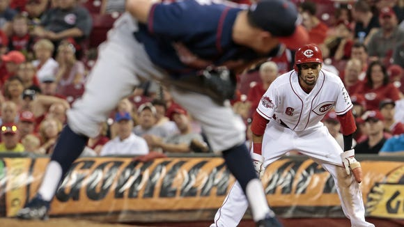 Twins relief pitcher J.R. Graham looks back to first base as Reds center fielder Billy Hamilton leads off during the bottom of the fifth inning Monday.