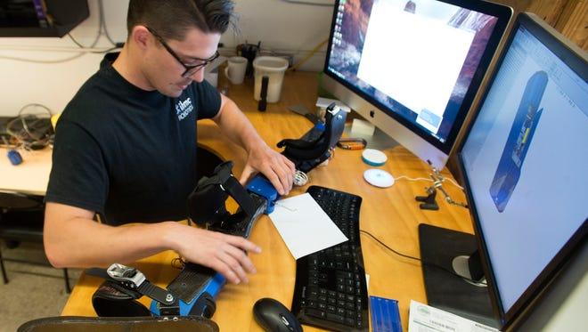 Institute for Human and Machine Corks Cognition Mechanical Engineer, Tyson Cobb, works on the development of a powered exoskeleton.