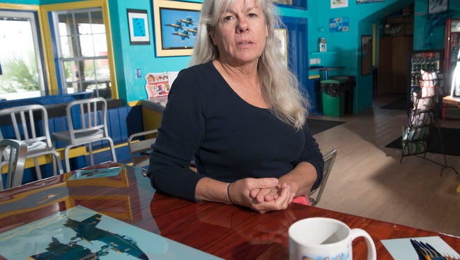 Lori Dell opened a new restaurant on Pensacola Beach in the old Surf Burger building, and while the beach eatery does not have an official name as of yet, her love of the Blue Angels is apparent in its decor.