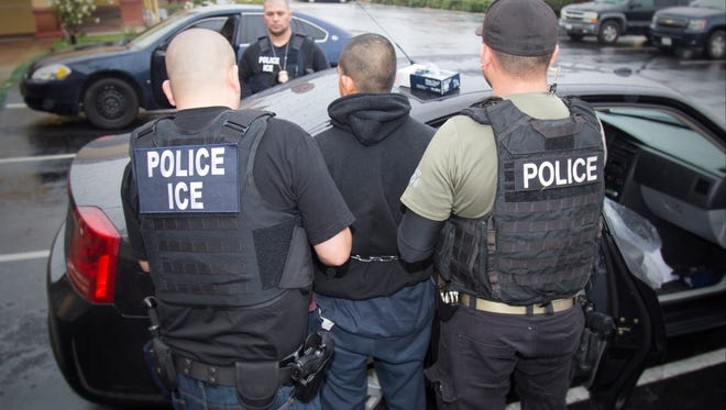 Immigration and Customs Enforcement officers arrest foreign nationals Feb. 7, 2017, during a targeted enforcement operation conducted aimed at immigration fugitives, re-entrants and at-large criminal aliens in Los Angeles.