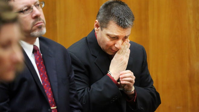 Peter Zielinski wipes away a tear during his sentencing for the 2011 murder of his wife, Lisa. Zielinski, Nov. 20, 2013.