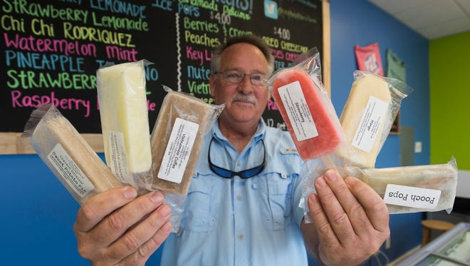Phillip Stephens shows off the wide variety of ice pops for sale at the Gulf Breeze location of Pop Brothers Artisan Ice Pop Makers on Thursday, Nov. 30. 2017.