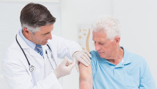 Doctor administering vaccine.