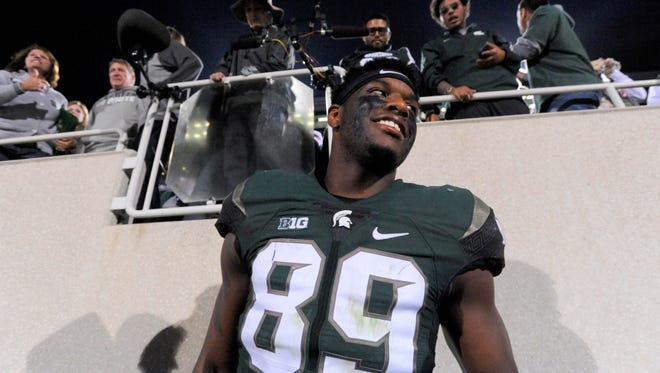 MSU's Shilique Calhoun celebrates with fans after MSU's tight 31-28 win at Spartan Stadium in East Lansing Sept. 12.