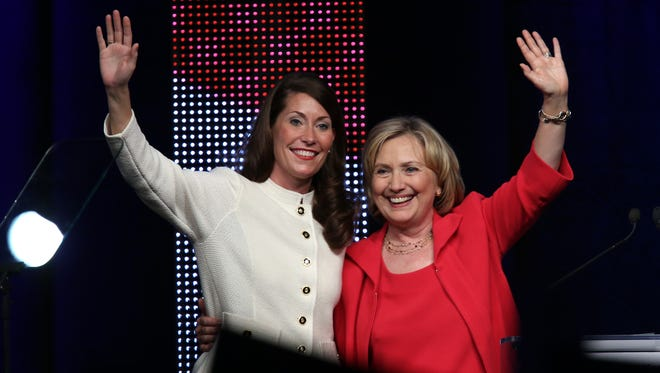Former U.S. Secretary of State Hillary Clinton campaigns for Alison Lundergan Grimes in  Louisville on Wednesday.