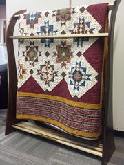This quilt rack was donated by Dave Easley in memory