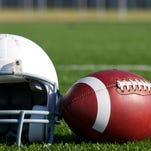 Football and Helmet on the Field.