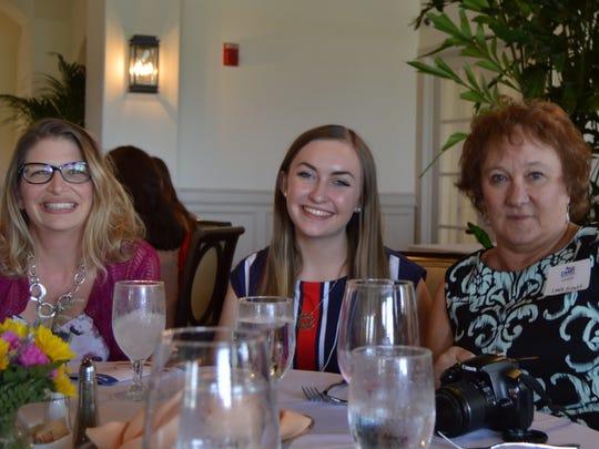 Autumn Schutt, center, and her mother Lisa Schutt,