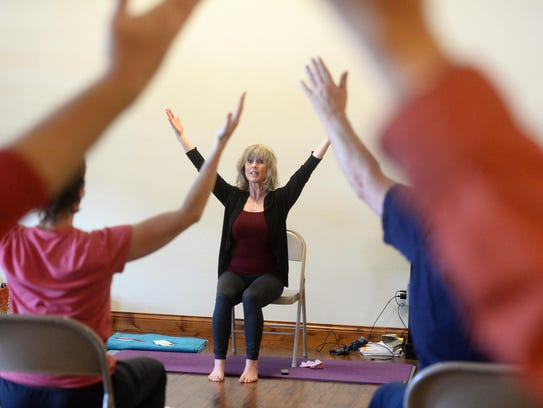 Pam Quinn of Yoga for Wellness leads a yoga class for