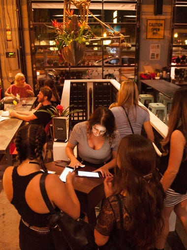 Intrepid diners check out the new Undertow Tiki Bar in Phoenix on Saturday, Aug. 27, 2016.