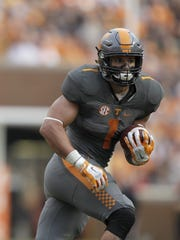 Tennessee running back Jalen Hurd (1) is one of 85 former Midstate high school players playing in bowl games.