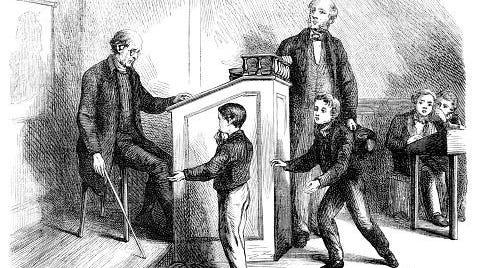 Teacher caning a school boy