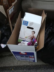 On Tuesday, trash sits on the curb outside of the home on Hackberry Street, in East Walnut Hills, where 2-year-old Glenara Bates was starved and tortured. According to a neighbor, everything that was in the home was placed outside by the landlord for trash pickup.