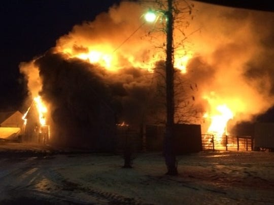 A barn is engulfed by flames at 343 310th St., north of Grinnell on Wednesday morning, Dec. 14.