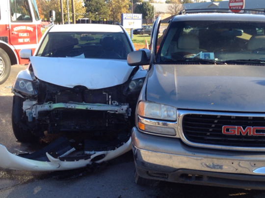 A 2008 Mazda CX-7 (left) driven by Chasity Beatty, 32, of Gassville, was southbound on College Street when a 2000 GMC Yukon (right) driven by Julie Kelly, 46, of Mountain Home, collided with her in front of Pinkston Middle School on Monday morning.