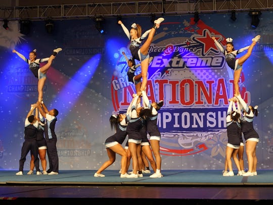 The Eastridge Lancers varsity cheerleaders execute a complicated move at the recent Cheerleading and Dance National Championship competition.