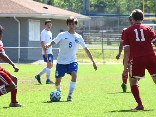 Robert E. Lee's Isaiah Knopp looks for an open teammate as Stonewall Jackson defenders converge during the second half of the Leemen's 8-0 victory over the Generals in the Shenandoah District boys soccer tournament championship game on Friday, May 25, 2018, at Winston-Wine Memorial Stadium in Staunton, Va.