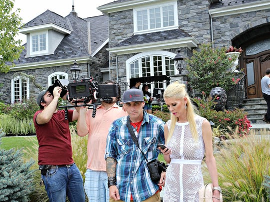 "Blackwood filmmaker Rob Hawk and actress Tara Reid take a break while filming scenes of the movie ""Worthless"" at a Mount Laurel residence."