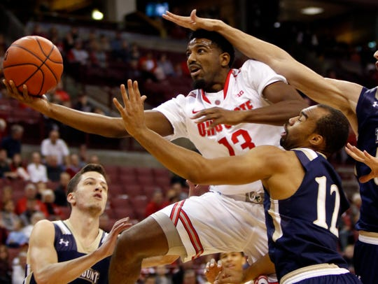 Ohio State's JaQuan Lyle (13) goes up for a shot against
